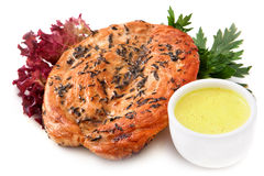 Turkey steak with sauce. Steak is the fried hen with sauce and herbs  on White Background Stock Image