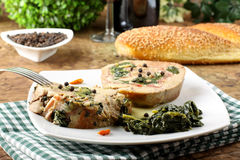 Turkey stuffed with spinach and bacon. On complex background Royalty Free Stock Images