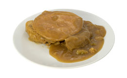 Turkey with stuffing and gravy on a white plate Stock Photo