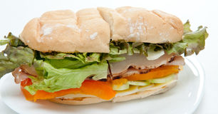 Turkey sub. A classic turkey sandwich on a calabrese roll with tomato, lettuce, cheese, cucumber and mayonaise. A lunchtime favorite Royalty Free Stock Images