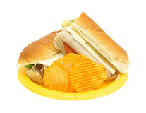 Turkey sub sandwich with chips on yellow plate Royalty Free Stock Photo