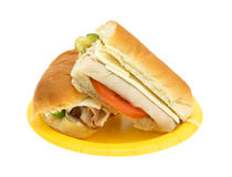 Turkey sub sandwich on a yellow paper plate Royalty Free Stock Photos