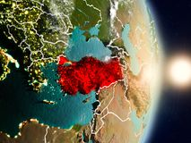 Turkey during sunrise. Highlighted in red on planet Earth with visible country borders. 3D illustration. Elements of this image furnished by NASA Stock Images