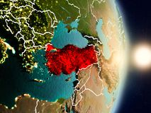 Turkey during sunrise. Highlighted in red on planet Earth with visible country borders. 3D illustration. Elements of this image furnished by NASA Royalty Free Stock Photo