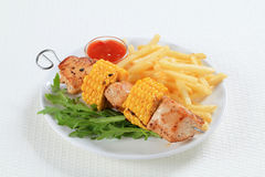 Turkey and sweetcorn skewer with French fries Stock Images