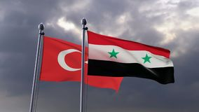 Two waving flags. Turkey and Syria flags waving against dark cloudy sky stock video footage