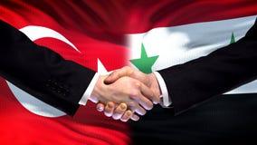 Turkey and Syria handshake, international friendship relations, flag background. Stock photo royalty free stock image