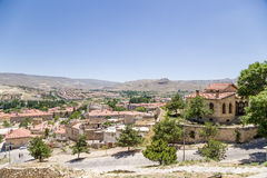 Turkey, Urgup. View of the city on a background of mountains Stock Photo