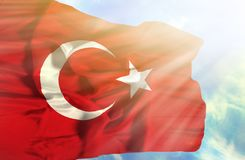 Turkey waving flag against blue sky with sunrays royalty free stock photos