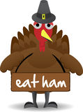 Turkey wearing eat ham sign anti-turkey Royalty Free Stock Photos