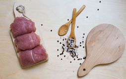 Turkey on wooden background with condiment and two wooden spoons Royalty Free Stock Photography