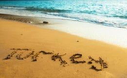 Turkey written on sandy beach. Of summer sunset over Mediterranian sea royalty free stock image