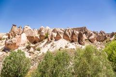 Turkiet Cappadocia Dalsikt Devrent med diagram av att rida ut (outliers) Arkivfoton