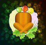 Turkije met fruit en groenten is op een plaat. Stock Foto