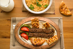 Turkish Adana Kebab with bulgur rice and ayran. Stock Photography