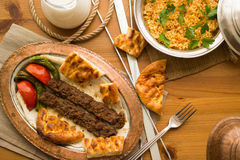 Turkish Adana Kebab with bulgur rice and ayran. Royalty Free Stock Photo