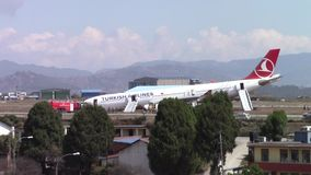Turkish Airlines Airbus crash at Kathmandu airport. KATHMANDU, NEPAL - MARCH 4, 2015: Turkish Airlines flight THY726 crashed earlier in the morning at Tribhuvan stock video