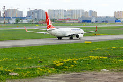 Turkish Airlines Boeing 737-8F2 aircraft  in Pulkovo International airport in Saint-Petersburg, Russia Royalty Free Stock Photo