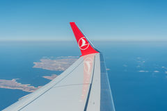 Turkish Airlines flying over the Maltese Islands. Wing of the Turkish Airlines flying while over the Maltese Islands Royalty Free Stock Photography