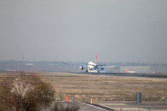 Turkish Airlines jet airliner approach to land at Madrid airport runway, seen from behind Stock Image