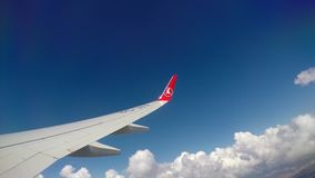 Turkish Airlines Plane Istanbul - TURKEY - 27 August 2016 - Jet plane flying through clouds. Window view with wing stock footage