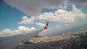Turkish Airlines Plane Istanbul - TURKEY - 27 August 2016 - Jet plane flying through clouds. Window view with wing stock video