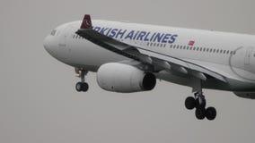 Turkish Airlines plane landing in the rain