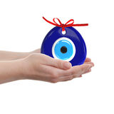 Turkish amulet. Evil eye. Over hands with white backgrounds , 3D. Render , 3D illustration Royalty Free Stock Photos