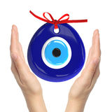 Turkish amulet. Evil eye. Over hands with white backgrounds , 3D. Render , 3D illustration Stock Photo