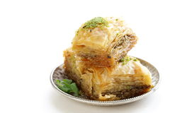 Turkish arabic dessert baklava with honey and nuts. On a silver plate Stock Images