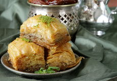 Turkish arabic dessert baklava with honey and nuts. On a silver plate Stock Photo