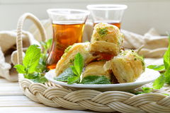 Turkish arabic dessert - baklava with honey and pistachios. Traditional Turkish arabic dessert - baklava with honey and pistachios Stock Image