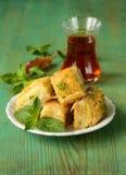Turkish arabic dessert - baklava with honey and pistachios Stock Photo