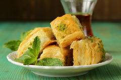 Turkish arabic dessert - baklava with honey and pistachios Royalty Free Stock Images