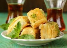 Turkish arabic dessert - baklava with honey and pistachios Stock Photos