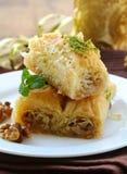 Turkish arabic dessert - baklava with honey and walnut Royalty Free Stock Photography