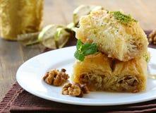 Turkish arabic dessert - baklava with honey and walnut Royalty Free Stock Photo