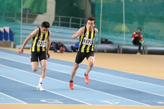 Turkish Athletic Federation Indoor Athletics Record Attempt Race. ISTANBUL, TURKEY - DECEMBER 23, 2017: Athletes running 60 meters during Turkish Athletic Stock Photography