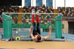 Turkish Athletic Federation Indoor Athletics Record Attempt Race. ISTANBUL, TURKEY - DECEMBER 23, 2017: Undefined athlete high jumping during Turkish Athletic Royalty Free Stock Photo