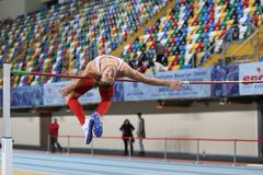 Turkish Athletic Federation Indoor Athletics Record Attempt Race. ISTANBUL, TURKEY - DECEMBER 23, 2017: Undefined athlete high jumping during Turkish Athletic Stock Image