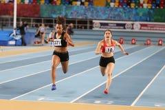 Turkish Athletic Federation Olympic Threshold Indoor Competition. ISTANBUL, TURKEY - JANUARY 14, 2018: Athletes running 60 metres hurdles during Turkish Athletic Stock Images