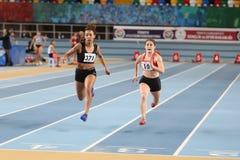 Turkish Athletic Federation Olympic Threshold Indoor Competition. ISTANBUL, TURKEY - JANUARY 14, 2018: Athletes running 60 metres hurdles during Turkish Athletic Stock Image