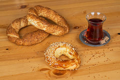 Turkish Bagel (Simit) and ay coregi with traditional Turkish tea. On a wooden surface Royalty Free Stock Images
