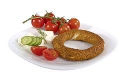 Turkish bagel, simit on breakfast plate Stock Photos