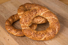 Turkish Bagel (Simit) on a wooden surface. Traditional Turkish Simit on a wooden surface Royalty Free Stock Photo