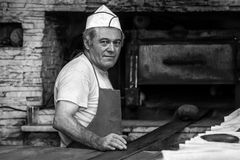 Turkish baker. Image of a baker in a traditional Turkish bakery in Istanbul. People in Turkey prefer hand-made bread and bakeries are to be found in all cities Stock Photo