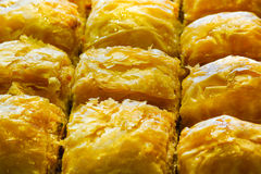Turkish baklava with Antep fistigi and sweet syrup peanut macro close up. Turkish baklava with Antep fistigi and sweet syrup peanut macro closeup Royalty Free Stock Image
