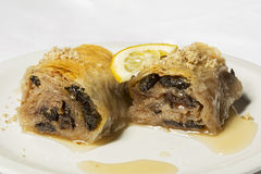 Turkish baklava dessert with nuts and dried dates Royalty Free Stock Images