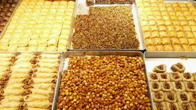 Turkish baklava at local Istanbul shop. Turkish baklava with lot of hazelnuts at local Istanbul shop. vertical panorama close up shot stock video footage