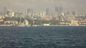 Sityscape from Bosphorus strait to the modern distruct of Istanbul with skyscrapers, Turkey. Video in 4K UHD, 3840 stock video footage